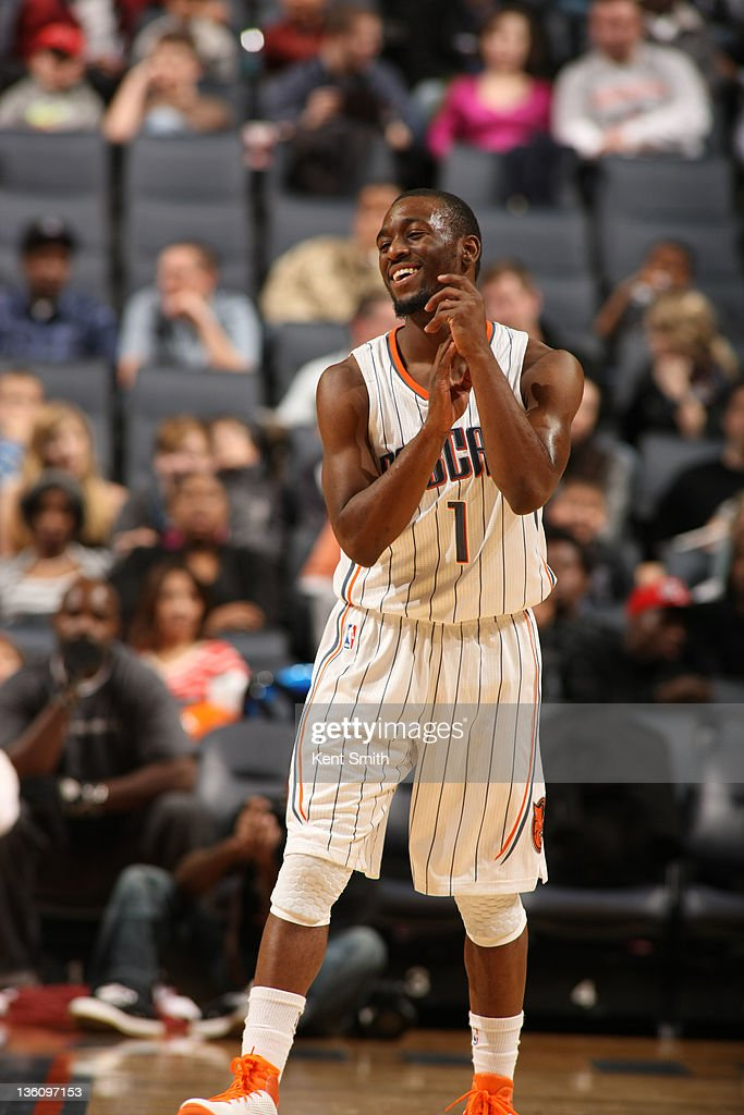 Kemba Walker #1 of the Charlotte Bobcats reacts on the court during the preseason game at the Time Warner Cable Arena on December 19, 2011 in Charlotte, North Carolina.
