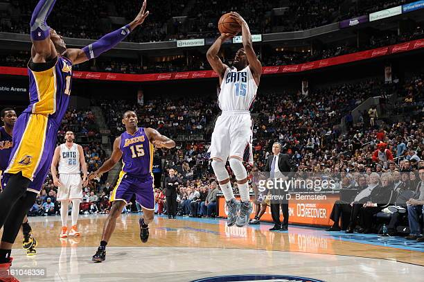 Kemba Walker of the Charlotte Bobcats shoots against Dwight Howard of the Los Angeles Lakers on February 8 2013 at the Time Warner Cable Arena in...