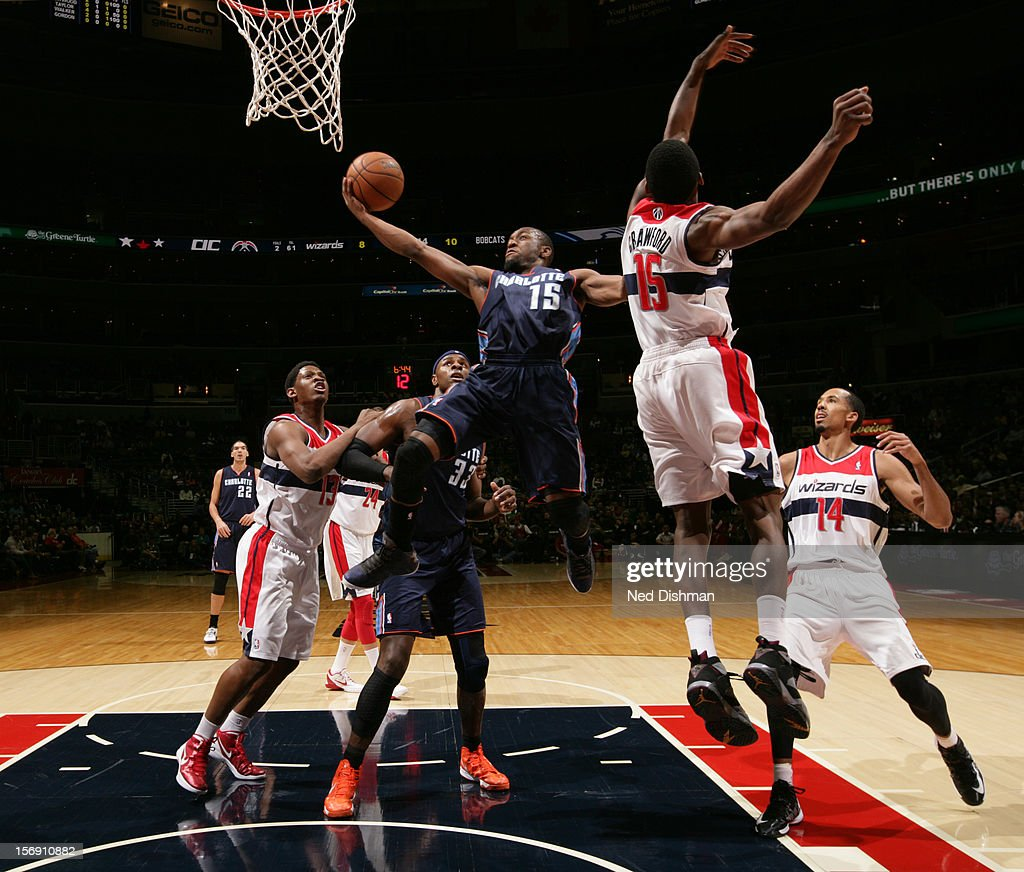 Kemba Walker #15 of the Charlotte Bobcats shoots against Jordan Crawford #15 of the Washington Wizards during the game at the Verizon Center on November 24, 2012 in Washington, DC.