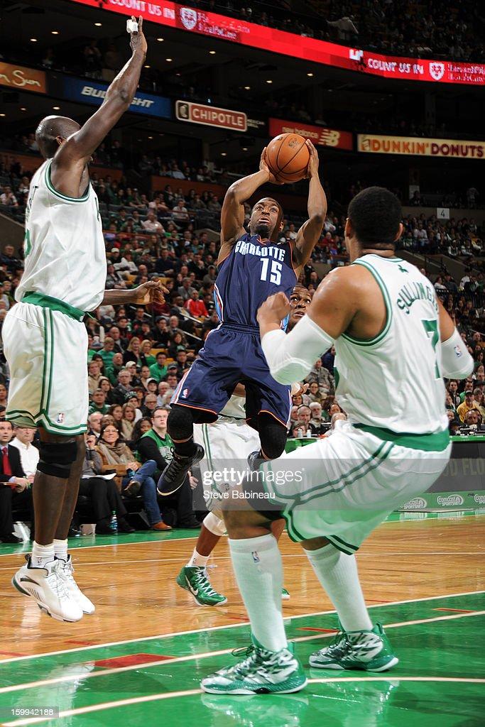 Kemba Walker #15 of the Charlotte Bobcats shoots against Kevin Garnett #5 and Jared Sullinger #7 of the Boston Celtics on January 14, 2013 at the TD Garden in Boston, Massachusetts.
