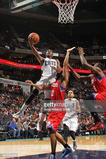 Kemba Walker of the Charlotte Bobcats shoots against the Philadelphia 76ers during the game at the Time Warner Cable Arena on December 6 2013 in...