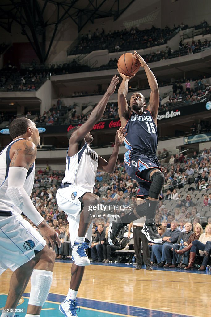 Kemba Walker #15 of the Charlotte Bobcats shoots the runner against Rodrigue Beaubois #3 of the Dallas Mavericks on October 26, 2012 at the American Airlines Center in Dallas, Texas.