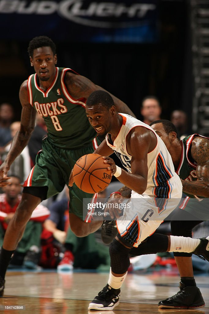 Kemba Walker #15 of the Charlotte Bobcats steals the ball against Larry Sanders #8 of the Milwaukee Bucks at the Time Warner Cable Arena on October 25, 2012 in Charlotte, North Carolina.