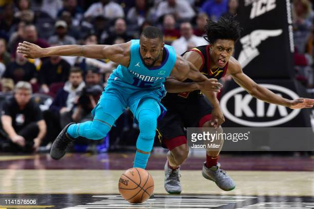 Kemba Walker of the Charlotte Hornets and Collin Sexton of the Cleveland Cavaliers fight for a loose ball during the second half at Rocket Mortgage...