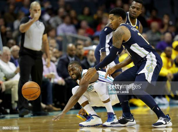 Kemba Walker of the Charlotte Hornets and Gary Harris of the Denver Nuggets go after a ball during their game at Spectrum Center on October 25 2017...
