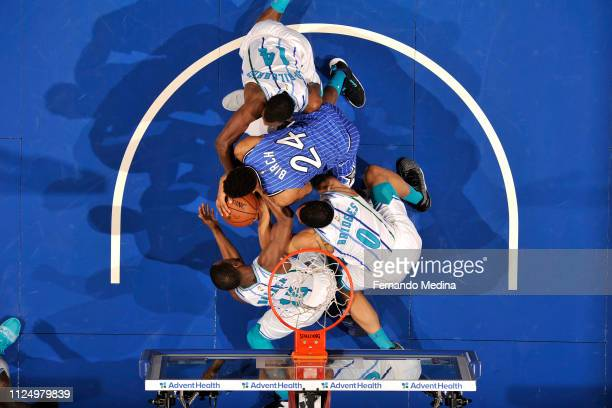 Kemba Walker of the Charlotte Hornets and Khem Birch of the Orlando Magic go for a loose ball during the game on February 14 2019 at Amway Center in...