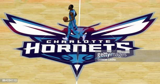 Kemba Walker of the Charlotte Hornets brings the ball up against the Atlanta Hawks during their game at Spectrum Center on October 20 2017 in...