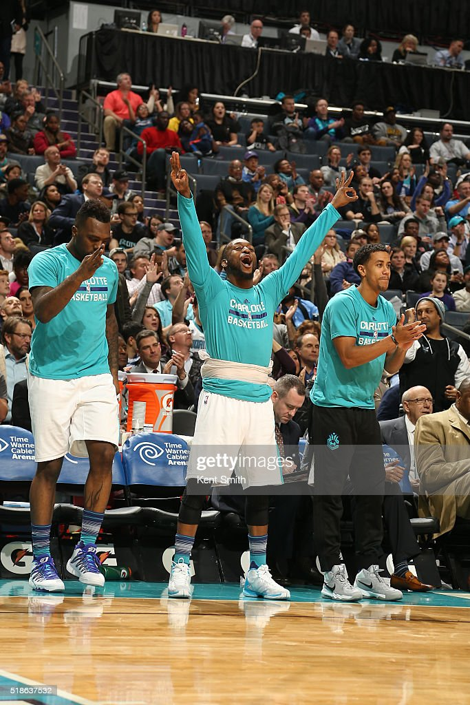 Kemba Walker #15 of the Charlotte Hornets celebrates with his team during the game against the Atlanta Hawks on January 13, 2016 at Time Warner Cable Arena in Charlotte, North Carolina.