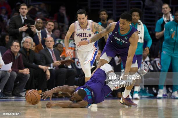 Kemba Walker of the Charlotte Hornets dives for the ball in front of JJ Redick of the Philadelphia 76ers in the fourth quarter at the Wells Fargo...