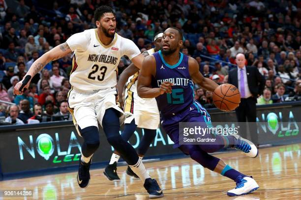Kemba Walker of the Charlotte Hornets drives the ball past Anthony Davis of the New Orleans Pelicans during the second half of a NBA game at the...