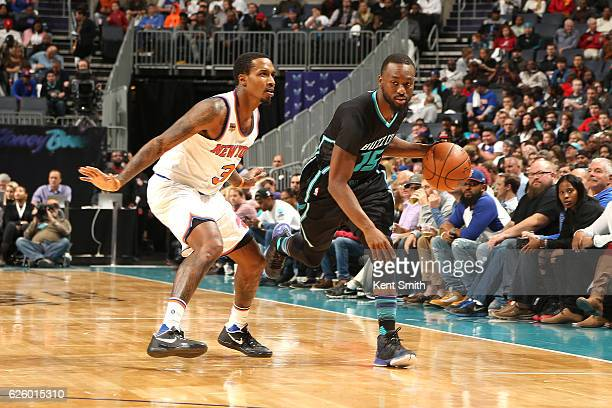 Kemba Walker of the Charlotte Hornets drives to the basket against Brandon Jennings of the New York Knicks during the game on November 26 2016 at...