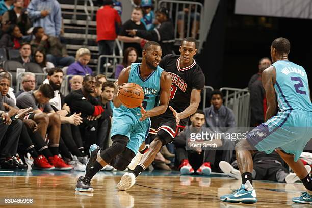 Kemba Walker of the Charlotte Hornets drives to the basket against the Chicago Bulls during the game on December 23 2016 at Spectrum Center in...