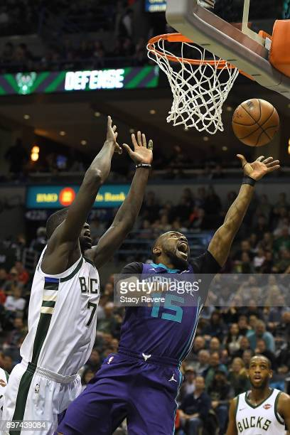 Kemba Walker of the Charlotte Hornets drives to the basket against Thon Maker of the Milwaukee Bucks during the second half of a game at the Bradley...