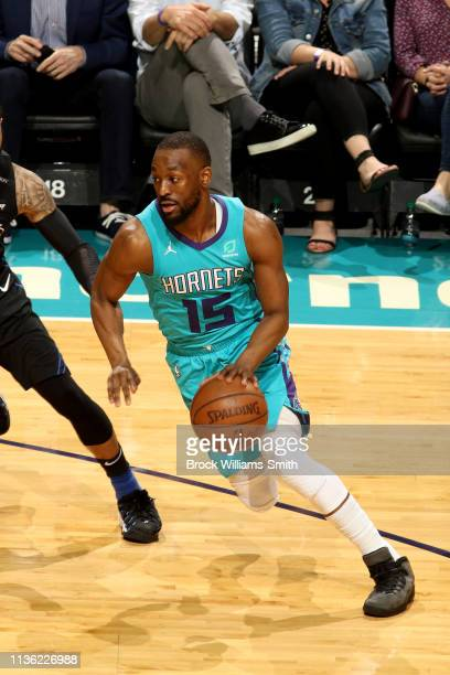 Kemba Walker of the Charlotte Hornets drives to the basket during the game against the Orlando Magic on April 10 2019 at Spectrum Center in Charlotte...