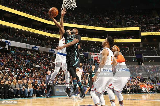 Kemba Walker of the Charlotte Hornets goes for a lay up against the New York Knicks during the game on November 26 2016 at Spectrum Center in...