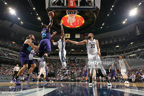 Kemba Walker of the Charlotte Hornets goes for the layup during the game against the Memphis Grizzlies on December 11 2015 at FedExForum in Memphis...