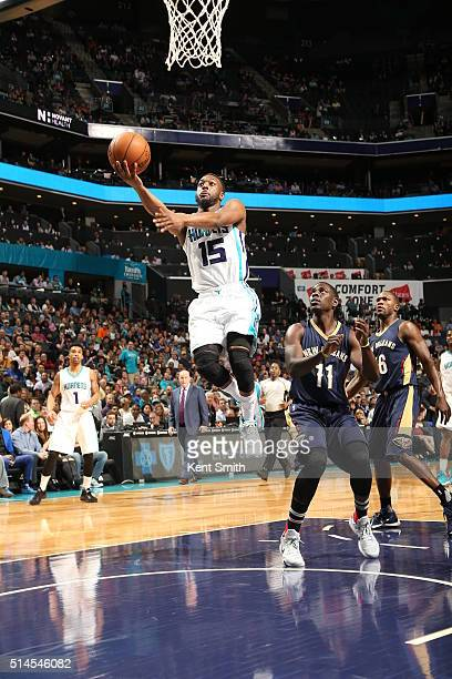 Kemba Walker of the Charlotte Hornets goes to the basket against the New Orleans Pelicans on March 9 2016 at Time Warner Cable Arena in Charlotte...