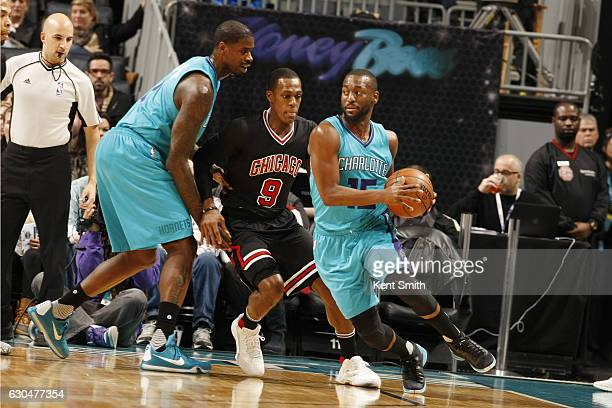Kemba Walker of the Charlotte Hornets handles the ball against Rajon Rondo of the Chicago Bulls during the game on December 23 2016 at Spectrum...