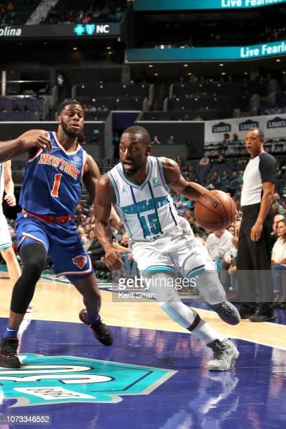 Kemba Walker of the Charlotte Hornets handles the ball against the New York Knicks on December 14 2018 at Spectrum Center in Charlotte North Carolina...