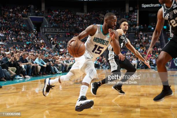 Kemba Walker of the Charlotte Hornets handles the ball against the San Antonio Spurs on March 26 2019 at the Spectrum Center in Charlotte North...