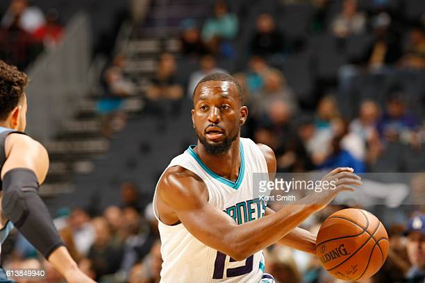 Kemba Walker of the Charlotte Hornets handles the ball against the Minnesota Timberwolves during a preseason game on October 10 2016 at the Spectrum...