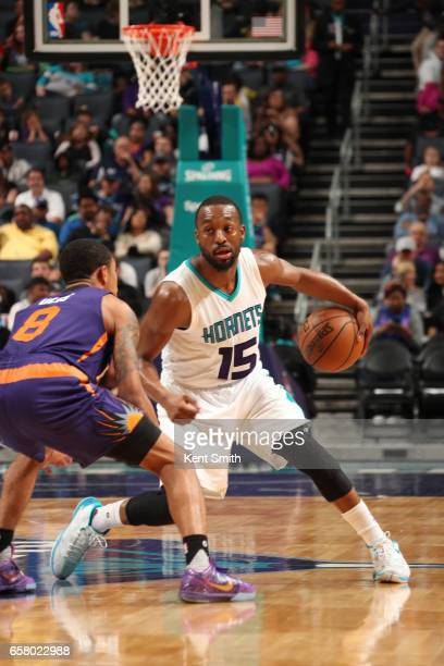 Kemba Walker of the Charlotte Hornets handles the ball against the Phoenix Suns on March 26 2017 at Spectrum Center in Charlotte North Carolina NOTE...