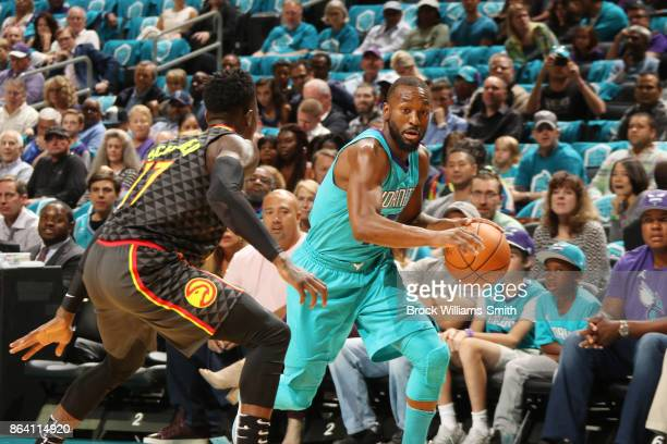 Kemba Walker of the Charlotte Hornets handles the ball against the Atlanta Hawks on October 20 2017 at Spectrum Center in Charlotte North Carolina...