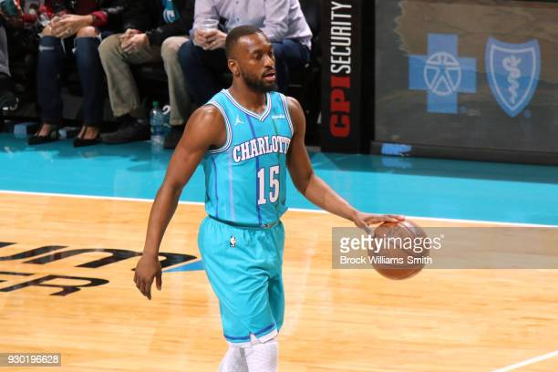 Kemba Walker of the Charlotte Hornets handles the ball against the Phoenix Suns on March 10 2018 at Spectrum Center in Charlotte North Carolina NOTE...