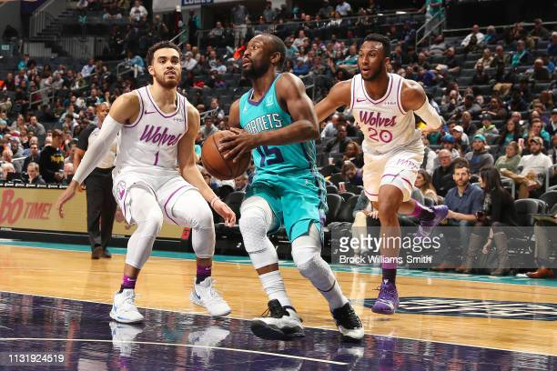 Kemba Walker of the Charlotte Hornets handles the ball during the game against Dario Saric of the Minnesota Timberwolves on March 21 2019 at Spectrum...