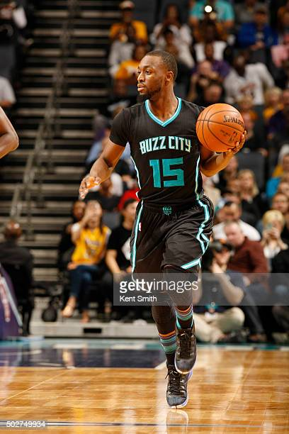 Kemba Walker of the Charlotte Hornets handles the ball during the game against the Los Angeles Lakers on December 28 2015 at Time Warner Cable Arena...