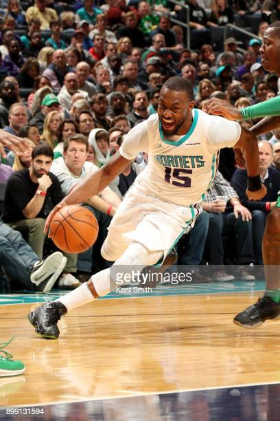 Kemba Walker of the Charlotte Hornets handles the ball during the game against the Boston Celtics on December 27 2017 at Spectrum Center in Charlotte...