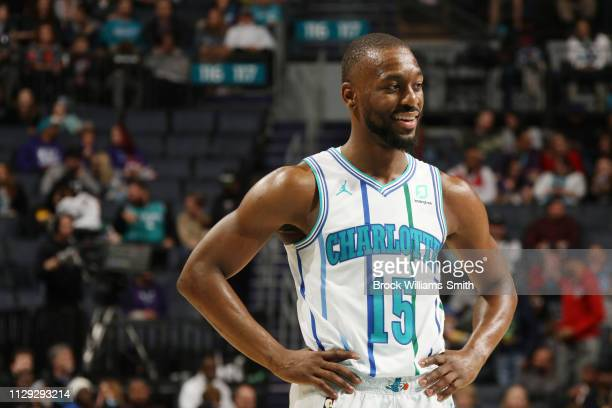 Kemba Walker of the Charlotte Hornets looks on during the game against the Washington Wizards on March 8 2019 at Spectrum Center in Charlotte North...