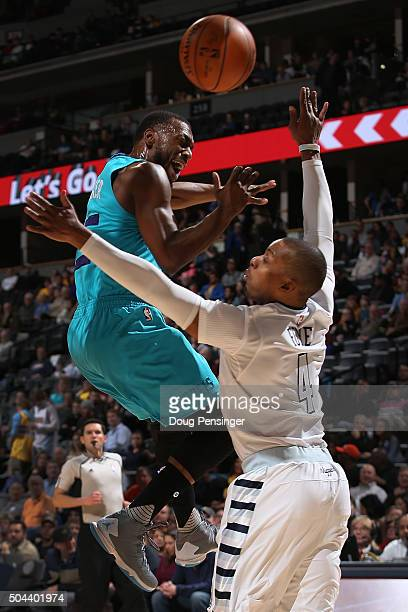 Kemba Walker of the Charlotte Hornets looses control of the ball against Randy Foye of the Denver Nuggets at Pepsi Center on January 10 2016 in...