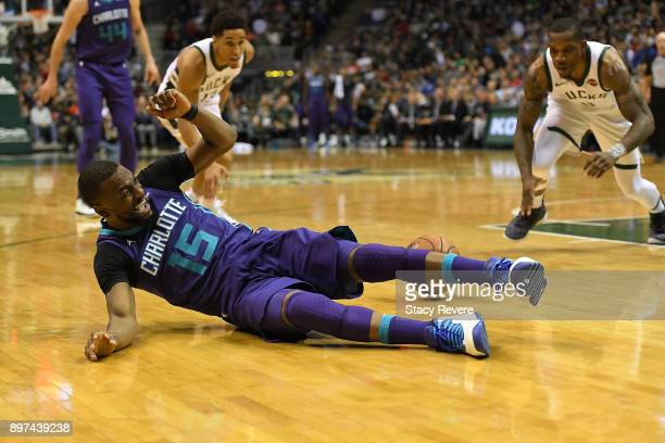 Kemba Walker of the Charlotte Hornets loses the ball during the second half of a game against the Milwaukee Bucks at the Bradley Center on December...