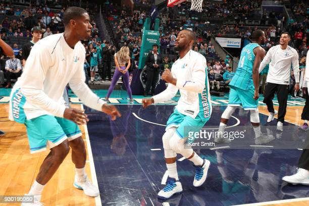 Kemba Walker of the Charlotte Hornets makes his entrance before the game against the Phoenix Suns on March 10 2018 at Spectrum Center in Charlotte...