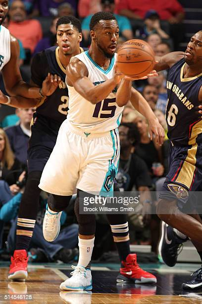 Kemba Walker of the Charlotte Hornets passes the ball against the New Orleans Pelicans during the game at the Time Warner Cable Arena on March 09...