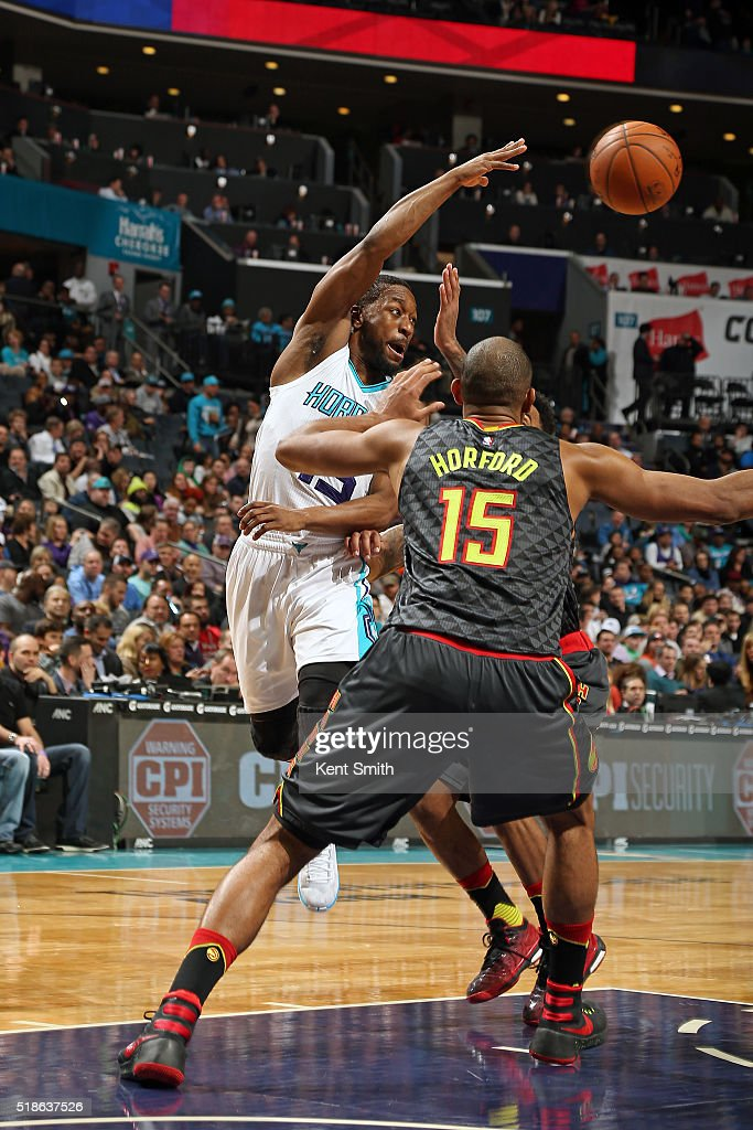 Kemba Walker #15 of the Charlotte Hornets passes the ball during the game against the Atlanta Hawks on January 13, 2016 at Time Warner Cable Arena in Charlotte, North Carolina.