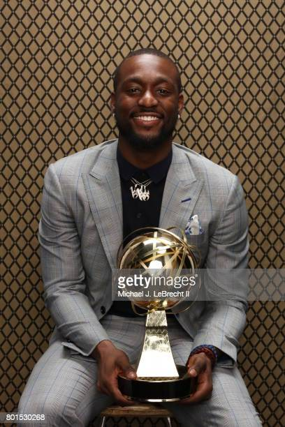 Kemba Walker of the Charlotte Hornets poses for a portrait after receiving the NBA Sportsmanship Award at the NBA Awards Show on June 26 2017 at...