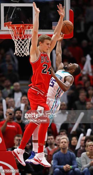 Kemba Walker of the Charlotte Hornets puts up and misses a shot against Lauri Markkanen of the Chicago Bulls in the final seconds at the United...