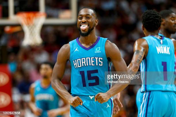Kemba Walker of the Charlotte Hornets reacts after a basket during the first half against the Miami Heat at American Airlines Arena on October 20...