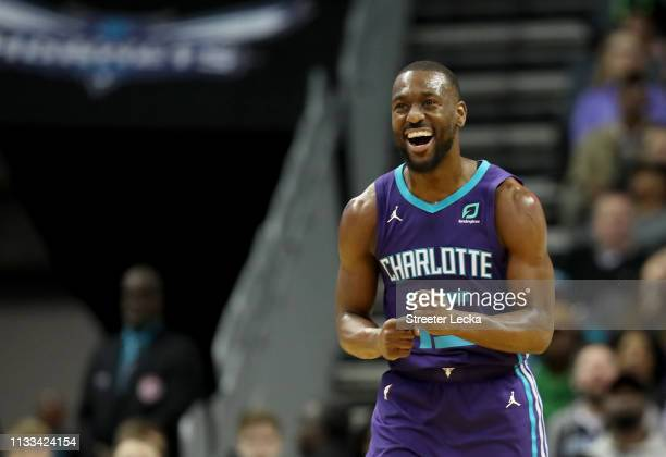 Kemba Walker of the Charlotte Hornets reacts after a play against the Portland Trail Blazers during their game at Spectrum Center on March 03 2019 in...