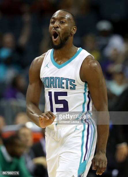 Kemba Walker of the Charlotte Hornets reacts after a play against the Orlando Magic during their game at Spectrum Center on October 29 2017 in...