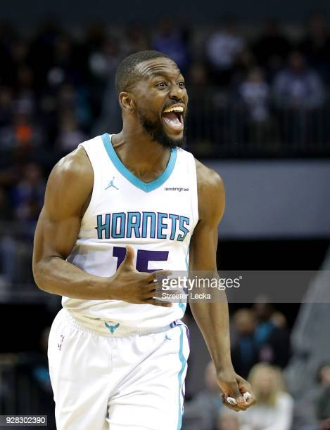 Kemba Walker of the Charlotte Hornets reacts after a play against the Philadelphia 76ers during their game at Spectrum Center on March 6 2018 in...