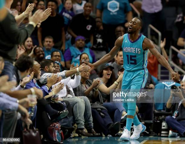Kemba Walker of the Charlotte Hornets reacts after a shot against the Atlanta Hawks during their game at Spectrum Center on October 20 2017 in...