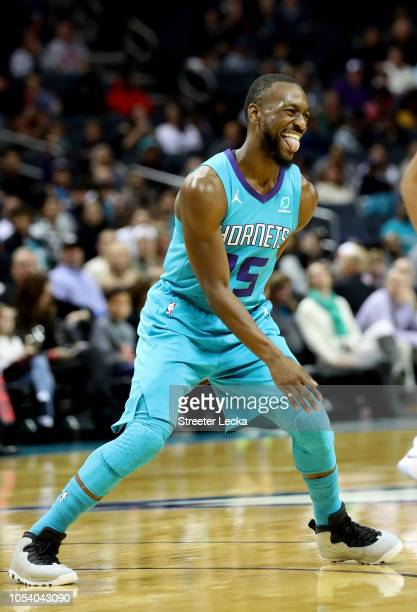 Kemba Walker of the Charlotte Hornets reacts after making a basket against the Chicago Bulls during their game at Spectrum Center on October 26 2018...