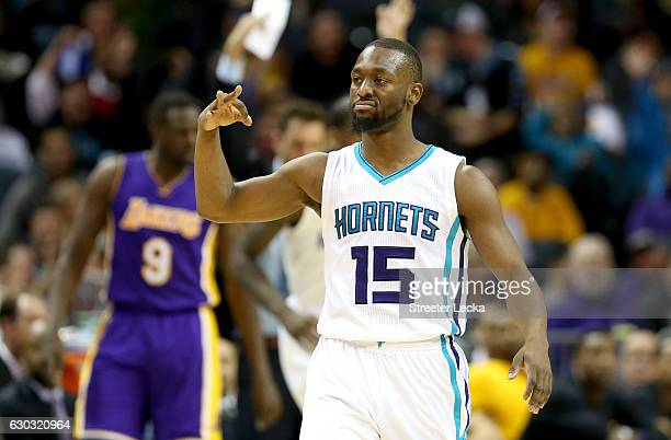 Kemba Walker of the Charlotte Hornets reacts after making a shot against the Los Angeles Lakers during their game at Spectrum Center on December 20...