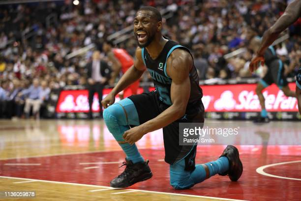 Kemba Walker of the Charlotte Hornets reacts against the Washington Wizards during the first half at Capital One Arena on March 15 2019 in Washington...