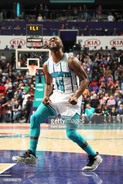 Kemba Walker of the Charlotte Hornets reacts to a play during overtime against the Philadelphia 76ers on November 17 2018 at Spectrum Center in...
