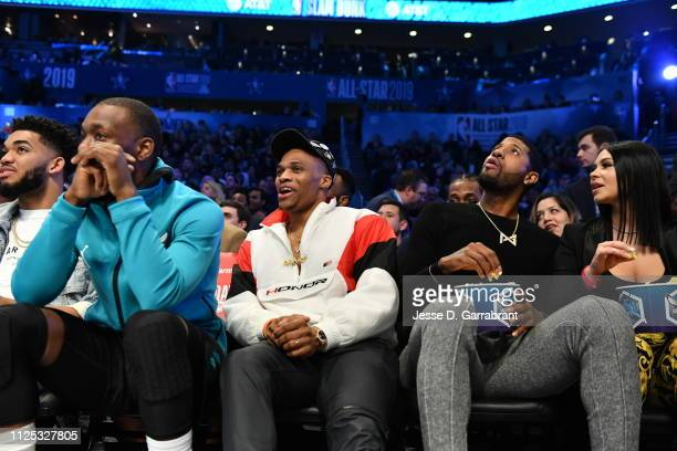 Kemba Walker of the Charlotte Hornets, Russell Westbrook and Paul George of the Oklahoma City Thunder look on during the 2019 AT&T Slam Dunk Contest...