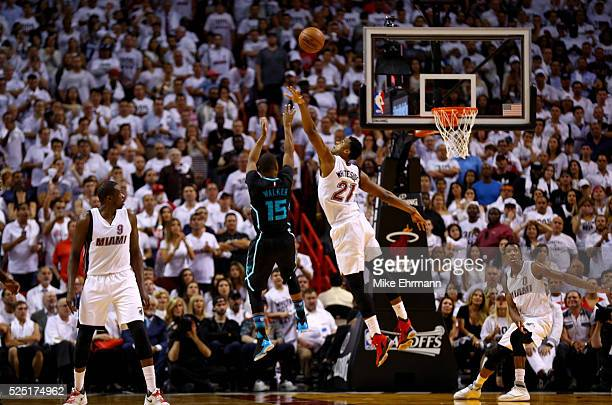 Kemba Walker of the Charlotte Hornets shoots over Hassan Whiteside of the Miami Heat during Game 5 of the Eastern Conference Quarterfinals of the...